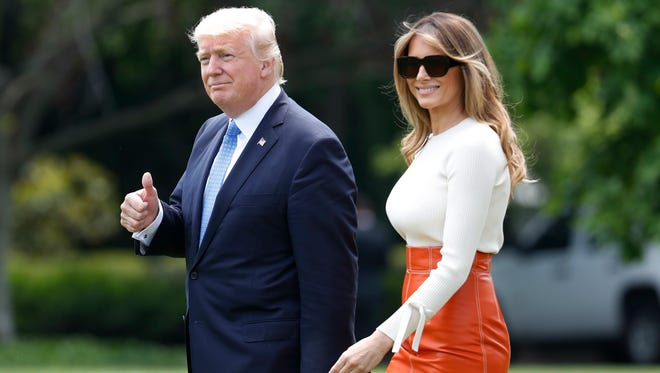 President Donald Trump and first lady Melania Trump depart the White House on May 19, 2017, for their first foreign trip. She wore a peppy orange leathery pencil skirt by Herve Pierre, white Max Mara knit top and Manolo Blahnik stilettos for the short hop to Andrews Air Force Base in Maryland.