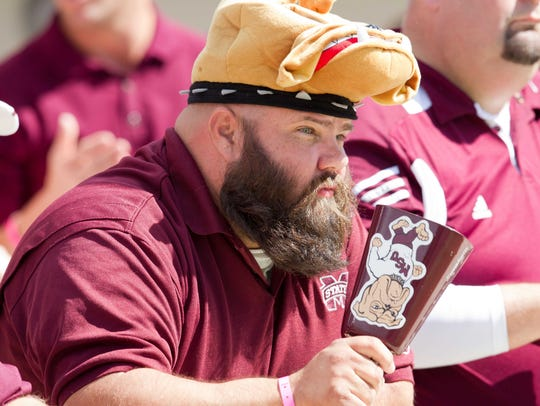 A Mississippi State Bulldogs fan rings his cowbell.