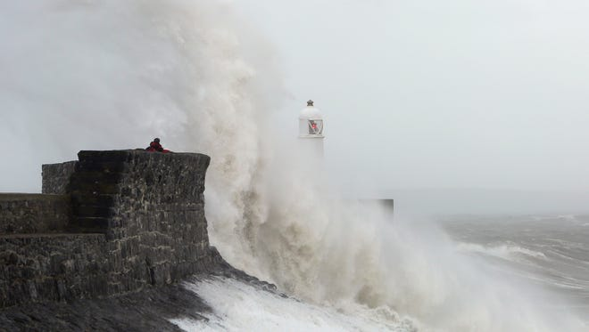 Waves crash against the sea barriers in Porthcawl, south Wales on Oct. 27, 2013.