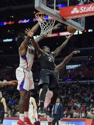 Jan 2, 2017: Phoenix Suns guard Eric Bledsoe (2) look to shoot defended by Los Angeles Clippers center DeAndre Jordan (6) in the fourth quarter during at Staples Center. The Clippers defeated the Suns 109-98.