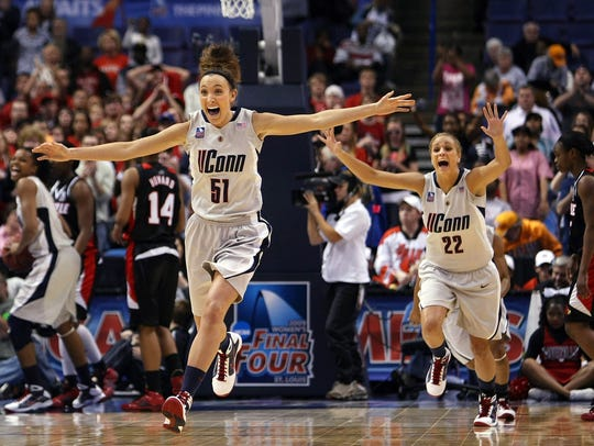 Cassie Kerns (left) celebrates UConn's victory in the