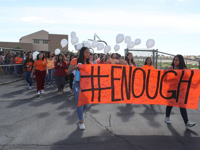 Students from La Quinta High School walk out of school