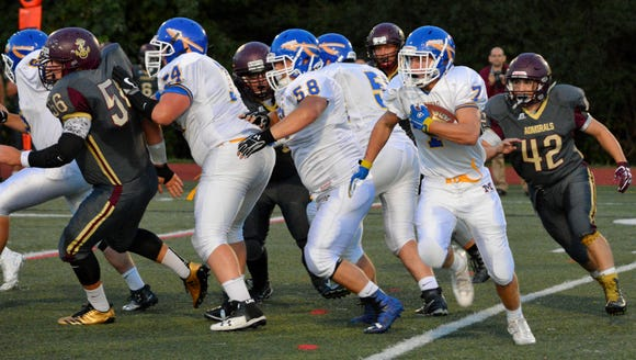 Mahopac tailback Tim Cegielski follows his line for