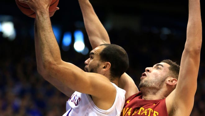 Kansas forward Perry Ellis, left, is fouled by Iowa State forward Georges Niang (31) during the first half.