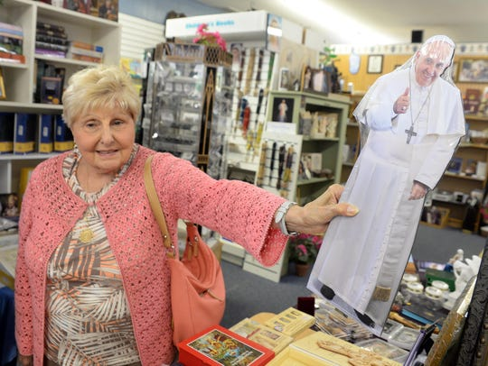 Josephine Caterina, from Vineland, holds up a figure