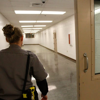 Records supervisor Sgt. Cook enters the medical facility,