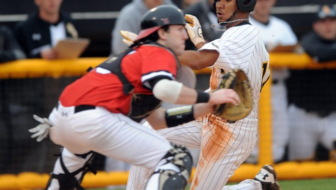 Southern Miss' LeeMarcus Boyd slides into home plate in the Golden Eagle's season opener against Northeastern.