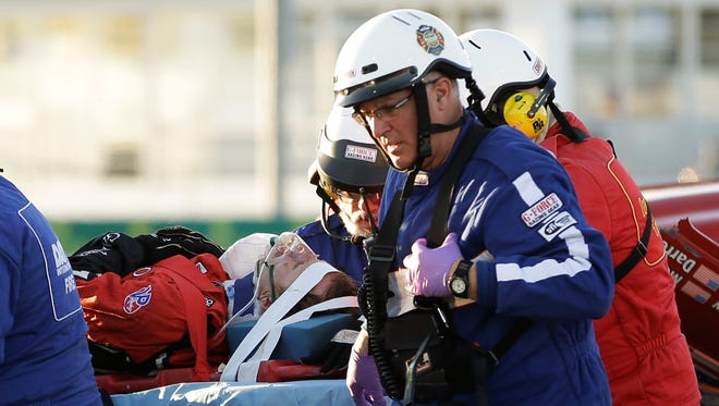 Rescue workers move driver Memo Gidley, center, to an ambulance after his scary crash Saturday night in the Rolex 24 at Daytona.