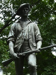 A statue of a minuteman stands at Washington's Headquarters