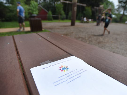 A typed message provided by Mahwah Community Parks is seen on a table at Winter's Park.