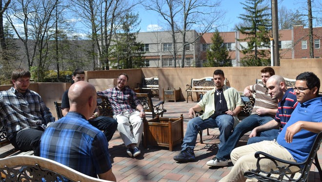 A meeting of those in recovery. Addicts who seek help at St. Christopher's Inn in Garrison can stay up to 90 days.