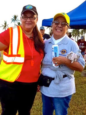 Guam Sunshine Lions Club member, Lion Dee Cruz, right, joined other volunteers in the 23rd Annual Guam International Coastal Cleanup held Sept. 16.  Pictured from left: Mary Santos; cleanup Site leader and Cruz.