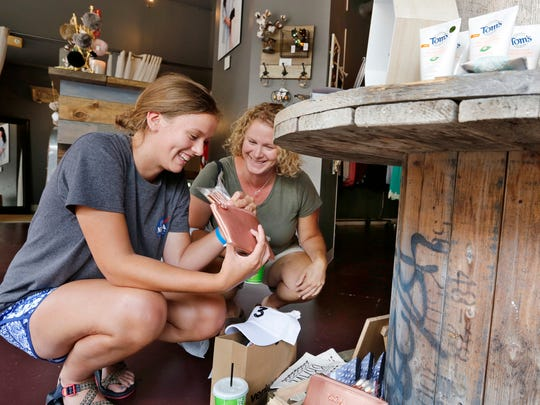 """Grace Waggoner, left, and her mother, Kelli Waggoner, check out a make up set as they shop at Dawson & Daisy Boutique Wednesday, July 19, 2017, 316 State Street in Wabash Landing in West Lafayette. """"We like little shops like this,"""" said Kelli Waggoner."""