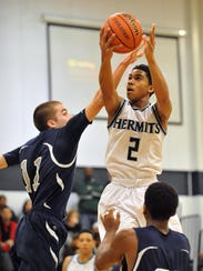 St. Augustine's Sa'eed Nelson (2) skies for a layup