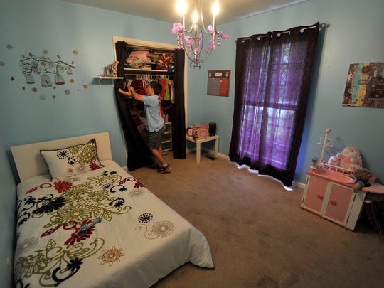 Ronan Morrison, 10, looks for toys in Keren's room at the family's home in Bellevue.