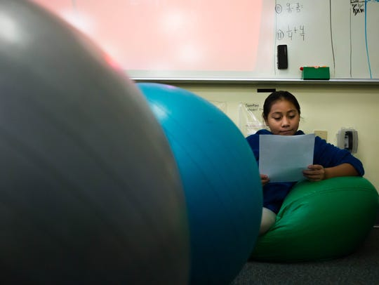 Anayeli Villeda, 10, finds a comfortable spot to read