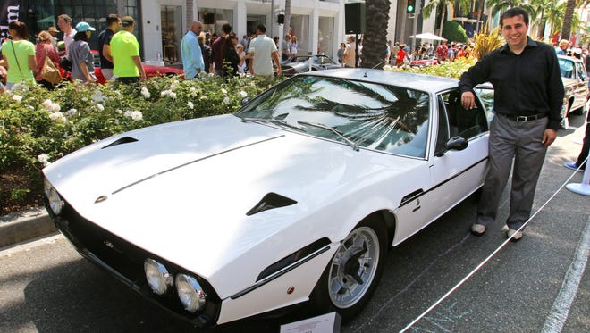 Saied Kashani stands with his 1971 Lamborghini Espada at the Rodeo Drive Concours d'Elegance in Beverly Hills.