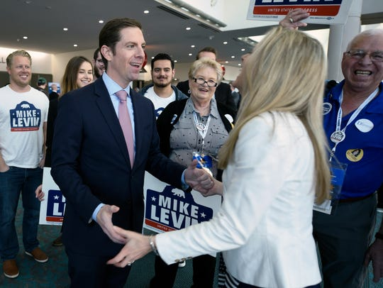 Democratic congressional candidate Mike Levin, left,