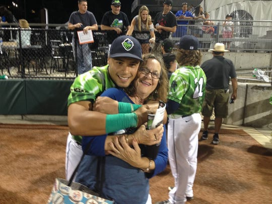Cheryl Aker gets hugged by Elvin Soto, whom she hosted