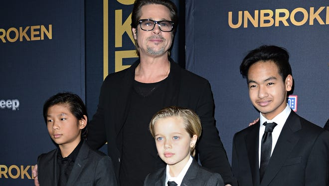 Brad Pitt with three of his children, Pax, Shiloh and Maddox, at premiere of 'Unbroken' in Hollywood, in December 2014.