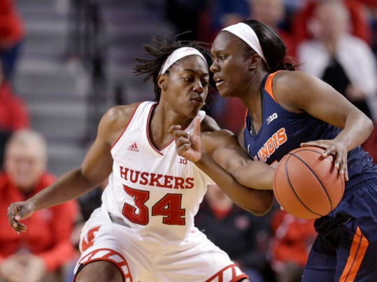 File-This Feb. 1, 2018, file photo shows Nebraska's Jasmine Cincore (34) reaching for the ball held by Illinois' Cierra Rice (5) during the first half of an NCAA women's college basketball game in Lincoln, Neb. Making the women's NCAA Tournament really wasn't Nebraska's goal at the start of the season. Coming off the worst year in program history, the Cornhuskers' wish list was filled with what would be considered more basic needs. Like team chemistry, learning how to play sound defense, winning some road games. (AP Photo/Nati Harnik, File)