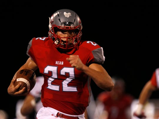 Nixa Eagles junior Sean Sample carries the football for a touchdown during a game against the Ozark Tigers at Nixa on Friday, Oct. 6, 2017