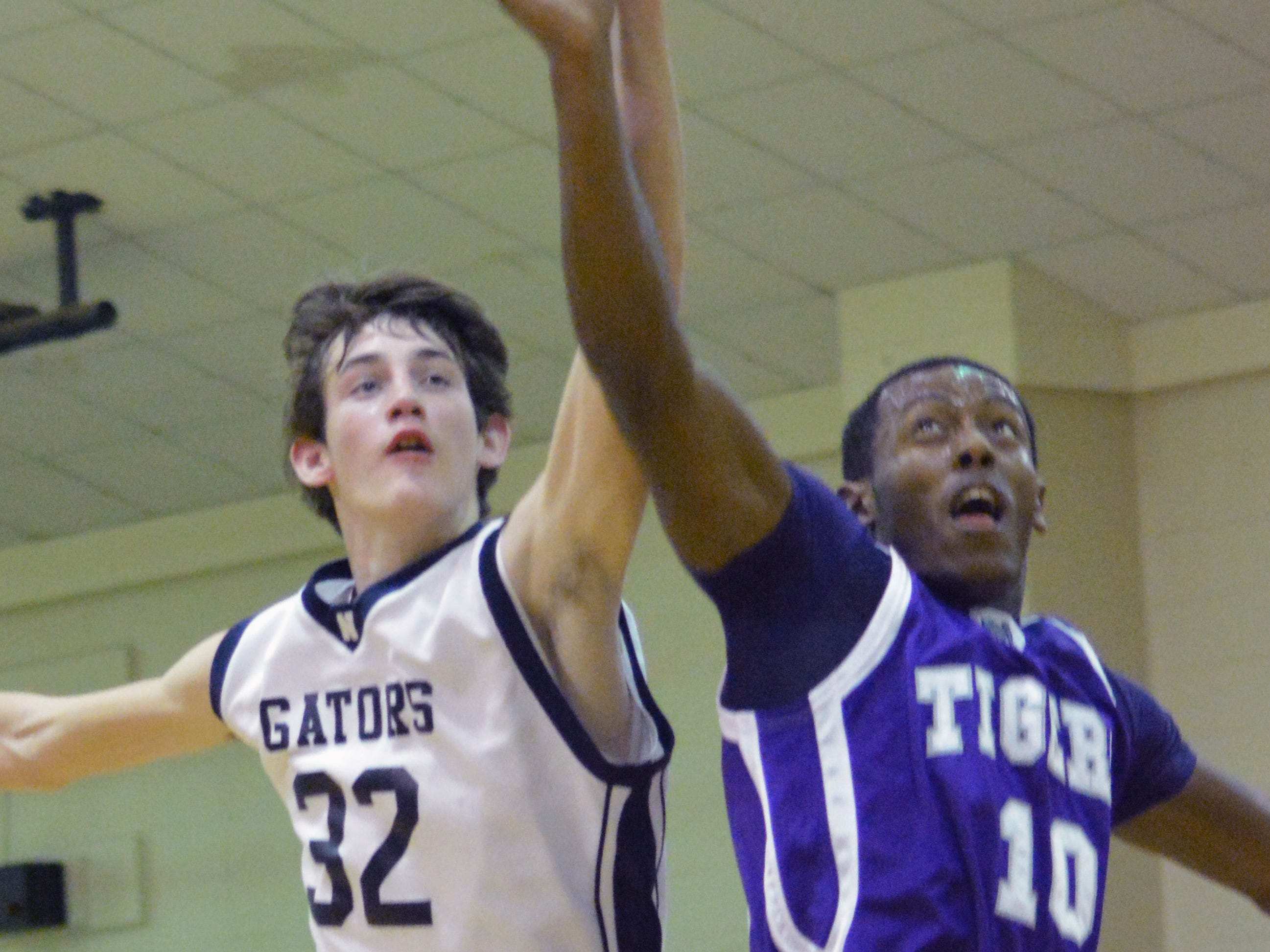 Northwood's Connor Grigg (32, left) and Montgomery's Chris Sykes (10, right) go after a rebound Friday.