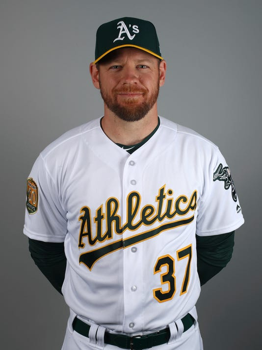 This Feb. 22, 2018 photo shows Brandon Moss of the Oakland Athletics baseball team. Moss has been released by the Athletics. He was acquired from Kansas City on Jan. 29 and was 4 for 10 with two walks in four spring training games. He was designated for assignment when Oakland claimed left-hander Jairo Labourt off waivers from Cincinnati on Sunday. (AP Photo/Ben Margot)