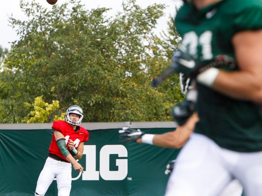 MSU QB Brian Lewerke throws during football practice Friday, August 4, 2017.  [MATTHEW DAE SMITH/Lansing State Journal]