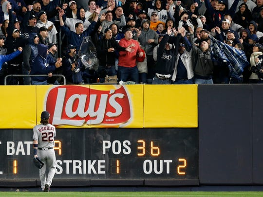Houston Astros' Josh Reddick watches the three run home run ball hit by New York Yankees' Todd Frazier during the second inning of Game 3 of baseball's American League Championship Series against the Houston Astros Monday, Oct. 16, 2017, in New York.