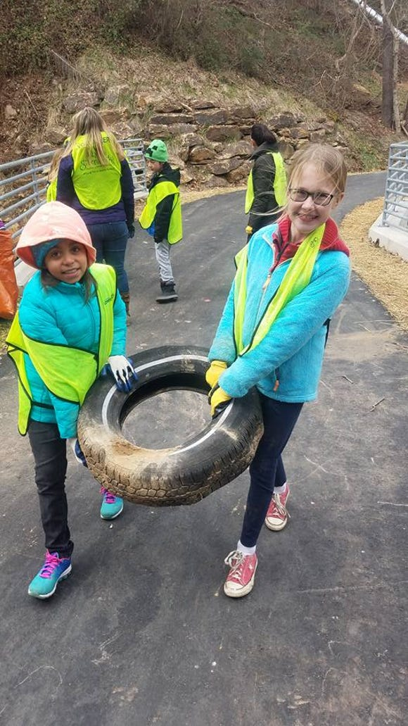 Young volunteers help with an Asheville GreenWorks litter cleanup. The nonprofit holds its Environmental Excellence Awards March 23.
