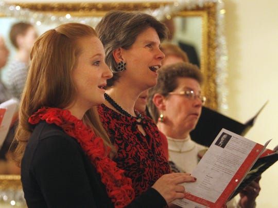Amber Swenk, left, Sara Dean and Debbie Klein sing