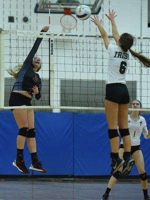 Mercy senior Kennedy Kuffner tries to put a spike attempt past Gabriel Richard's Jesse Fannon in the Catholic League championship match.