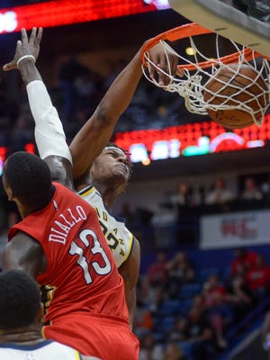 Indiana Pacers forward center Myles Turner, right, dunks the ball against New Orleans Pelicans forward Cheick Diallo (13) during the first half of an NBA basketball game in New Orleans on Wednesday, March 21, 2018.