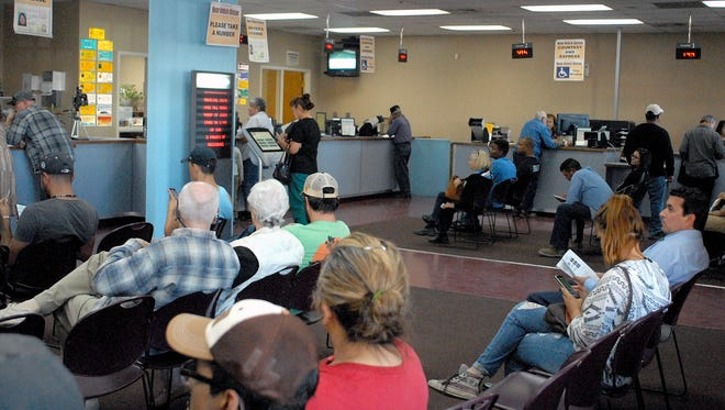 Rsidents wait at the Motor Vehicle Division office on Main Street in Las Cruces on Monday. The state's driving IDs are getting an overhaul to comply with tougher federal identification requirements and so the state can continue granting driving privileges to people who are in the country illegally.