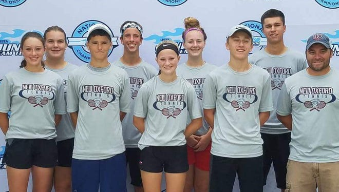 The Ox Strong tennis team competed in the USTA National Championships, in Orlando, Fla., on Oct. 1, 2017. Pictured, front row, from left, Kasi Conjack, Michael Pagnanelli, Julianna Cassady, Brian Klunk and coach Travis Martin. Back row, from left, Kamdyn Balko, Nick Wool, Dagney Markle and Justin Gruver.