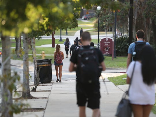 Students walk on FSU campus, one day after the university