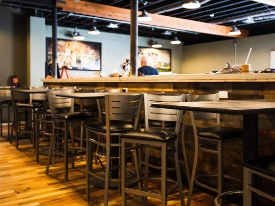 High top tables sit inside Art's Pub as the final bits