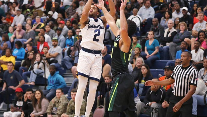 Jackson State guard Edric Dennis, left, led the Tigers in scoring for the second game in a row Monday night in another loss for JSU.