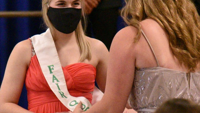 Rebekah Thompson, receives her 2020 Tri-Rivers Fair Queen sash from Sydney Hynes, 2019 Fair Queen, during the ceremony in the 4-H Building on Wednesday evening. Thompson represents the Friendly Valley 4-H club.