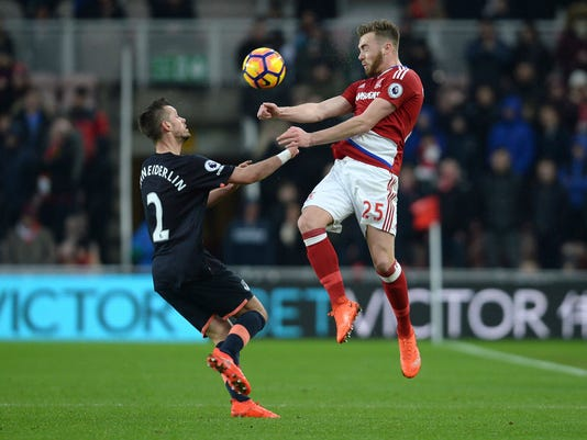 Everton's Morgan Schneiderlin, left, and Middlesbrough's Calum Chambers battle for the ball during their English Premier League soccer match at the Riverside Stadium, Middlesbrough, England, Saturday, Feb. 11, 2017. (Anna Gowthorpe/ PA via AP)