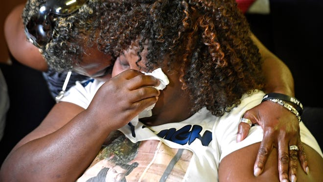 Jocques Clemmons' mom SheIia Clemmons is comforted as she cries before family and friends met for  a press conference at the Nashville NAACP headquarters on Jefferson Street. Thursday May 11, 2017, in Nashville, TN