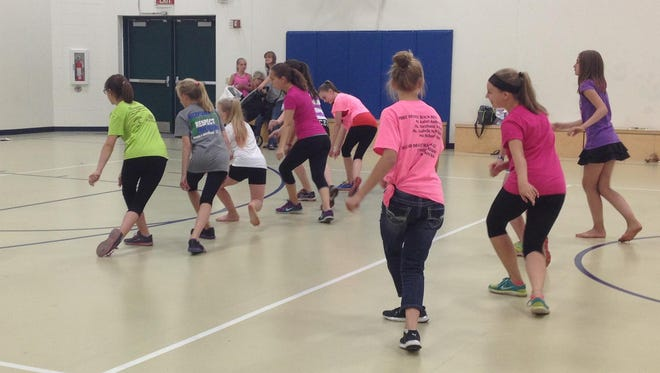 """Boys & Girls Club members learn their dance to """"Life is a Highway"""" for the Kids from Wisconsin tour."""