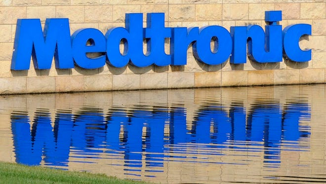 Medical device maker Medtronic' Medtronic Inc. reports its fiscal first-quarter earnings jumped to $830 million but revenue fell.