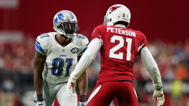 Wide receiver Calvin Johnson (81) of the Detroit Lions and cornerback Patrick Peterson of the Arizona Cardinals face off at the line of scrimmage in the second quarter Sunday, Nov. 16, 2014, in Glendale, Ariz.