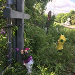 Bicyclists pay respects where 5 were killed north of Kalamazoo