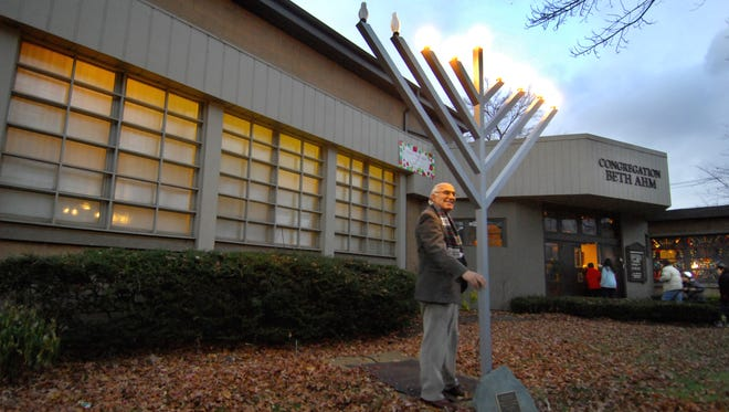 Rabbi Aaron Kriegel checks the light switch on Congregation Beth Ahm of West Essex's outdoor menorah in December 2010. Upon its 2017 closing, the Verona house of worship donated the menorah to the township.