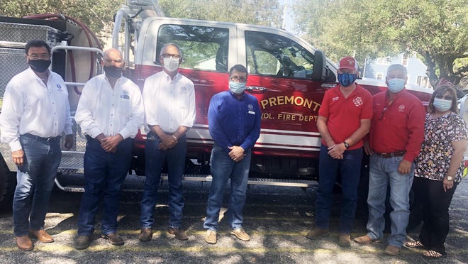 "The Premont Fire Department received a new brush truck to their fleet. Pictured (LtoR) are County Clerk JC Perez III, County Commissioner Ventura Garcia, Commissioner Carlos ""Coach"" Gonzalez, Jim Wellls County Judge Juan Rodriguez, Premont Fire Chief Jerry LaRue, Commissioner Wicho Gonzalez and Commissioner Margie Gonzalez."