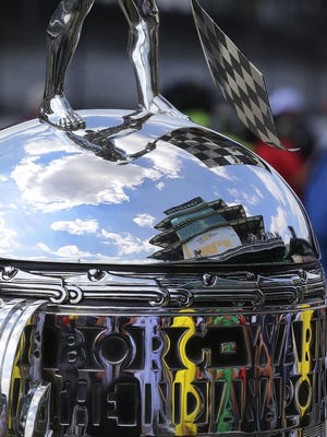 The midsection of the Borg-Warner Trophy reflects the Pagoda during qualifying for the Indianapolis 500 on Armed Forces Pole Day May 22, 2016, at the Indianapolis Motor Speedway.