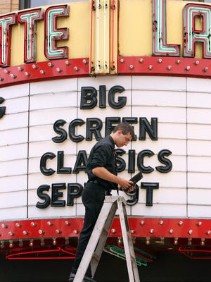 The Big Screen Classics film festival, a fixture at Suffern's Lafayette Theatre since 2003, may have screened its last classic, as theater owner Ari Benmosche has decided not to renew his contract with the town of Ramapo. Here, a Lafayette volunteer adds the series to the marquee in 2007.